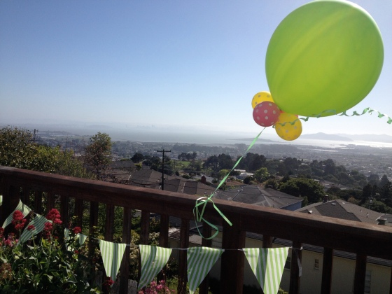 Baby shower balloons on the porch at Dad's house. Perfect green, yellow and pink palette for celebrating the Bean!